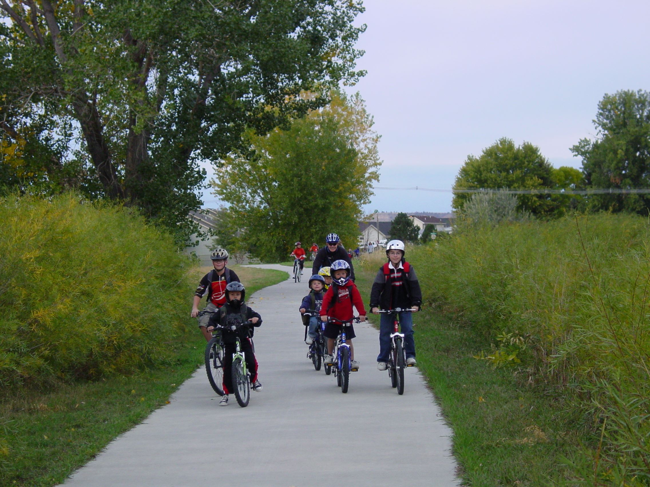 Mayor riding with kids on trail for Bike to School Week
